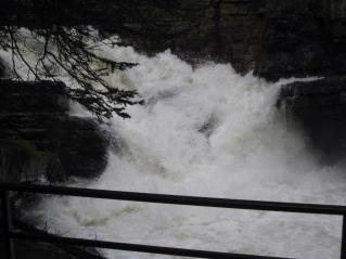Water rushing through Johnston Canyon