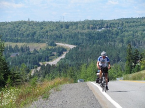 Rich cycling uphill in Nova Scotia