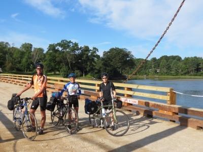 Cyclists crossing a closed bridge