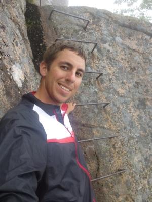 Carl climbing Precipice