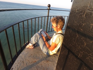Reading on the lighthouse catwalk