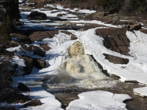 Beaver River flowing through ice
