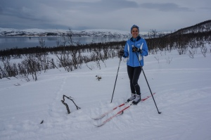 Molly skiing by the fjord