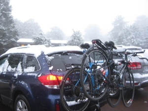 Bikes on snowy car