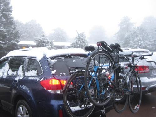 Bikes on snowy car