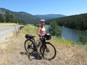 Molly cycling Clark Fork River