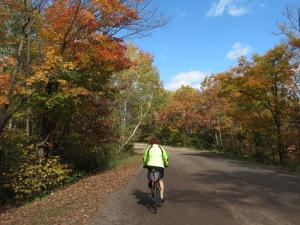 Myra cycling away from Hawk's Ridge