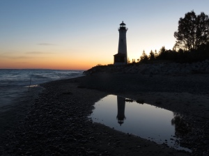 Lighthouse sunrise reflection