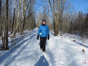 Kristina walking the trail