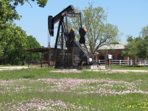 Oil rig with wildflowers