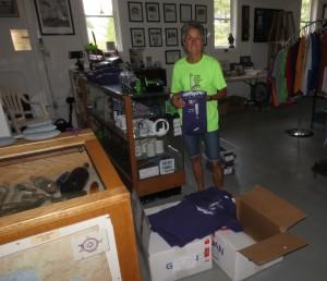 Molly putting away CPL tshirts
