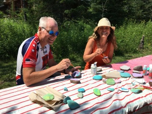 Rich and HeatherMarie painting rocks