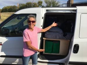 Molly showing campervan storage