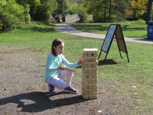 Mya playing Jenga in Pop Up Park