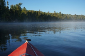 Kayaking with lake mist