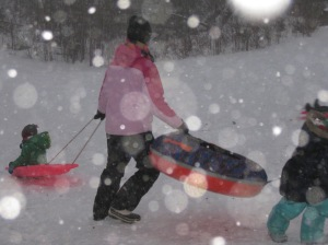 Karen and kids sledding in blizzard